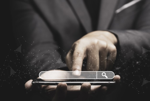 businessman-touching-smartphone-use-searching_50039-2051